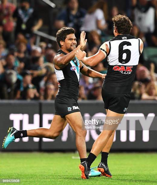 Jake Neade of Port Adelaide celebrates a goal with Steven Motlop of Port Adelaide during the round five AFL match between the Port Adelaide Power and...