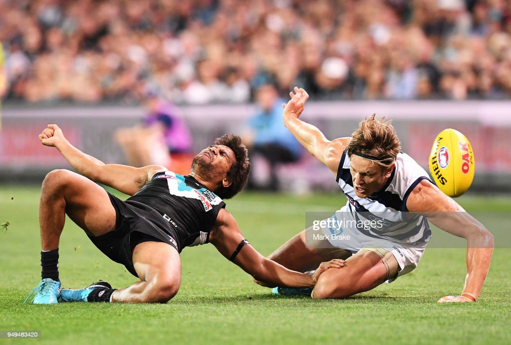 Jake Neade of Port Adelaide tackled high by Rhys Stanley of the Cats during the round five AFL match between the Port Adelaide Power and the Geelong Cats at Adelaide Oval on April 21, 2018 in Adelaide, Australia.