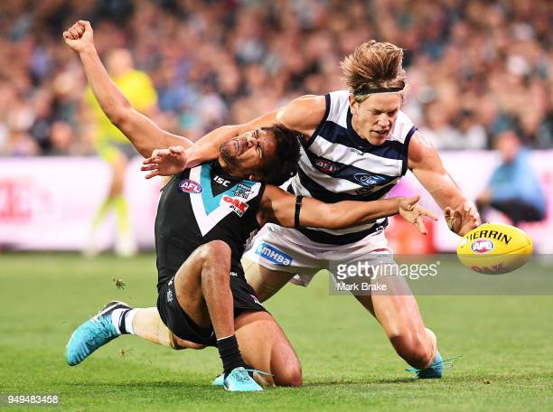 Jake Neade of Port Adelaide tackled high by Rhys Stanley of the Cats during the round five AFL match between the Port Adelaide Power and the Geelong...