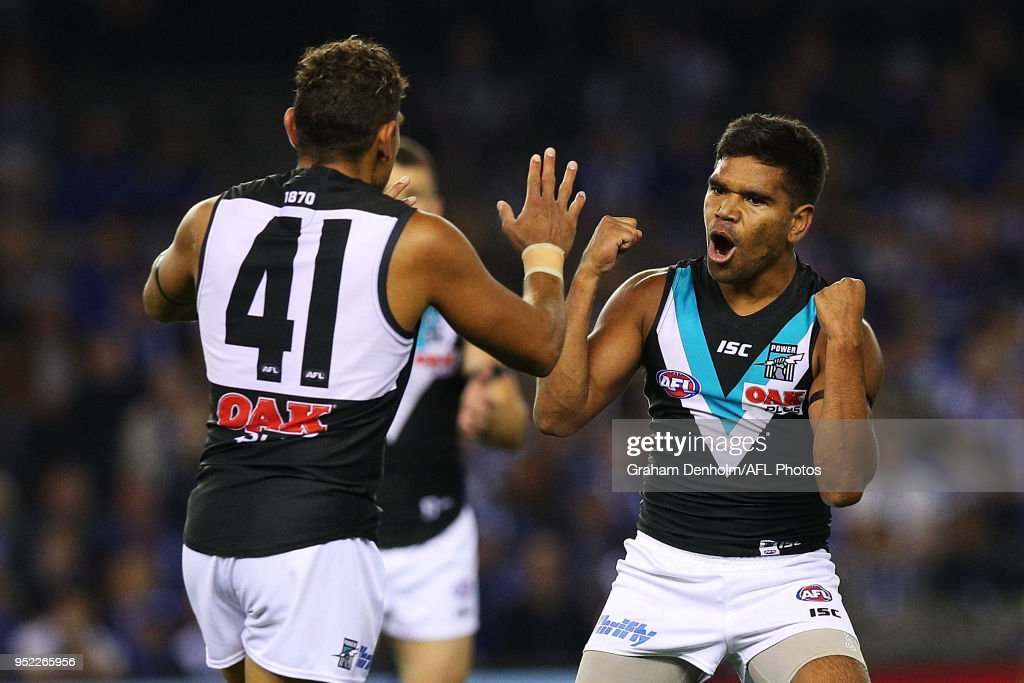 Jake Neade of the Power (R) celebrates kicking a goal during the round six AFL match between the North Melbourne Kangaroos and Port Adelaide Power at Etihad Stadium on April 28, 2018 in Melbourne, Australia.
