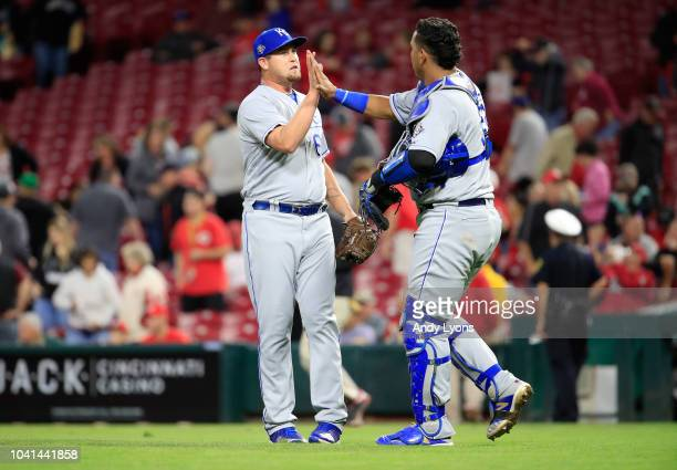Jake Newberry of the Kansas City Royals celebrates with Salvador Perez after the final out of the 61 win over the Cincinnati Reds at Great American...