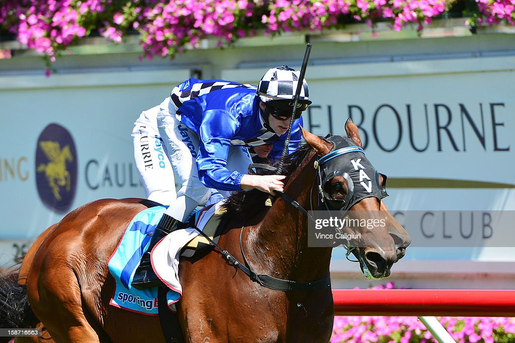Jake Noonan riding Undeniably wins the Jack & Muriel Magee Memorial Christmas Stakes at Caulfield Racecourse on December 26, 2012 in Melbourne, Australia.