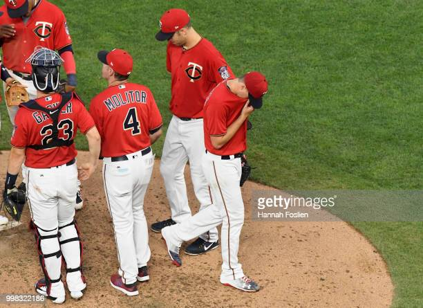 Jake Odorizzi of the Minnesota Twins is pulled from the game against the Tampa Bay Rays by manager Paul Molitor during the fifth inning on July 13...