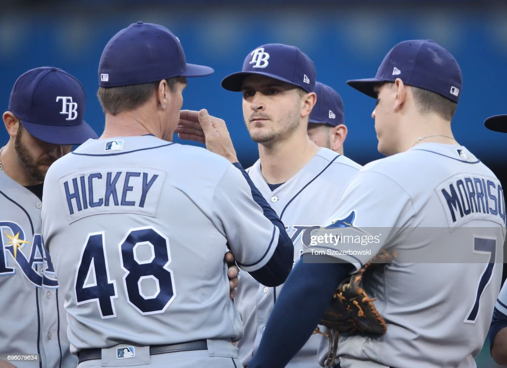 Jake Odorizzi #23 of the Tampa Bay Rays is visited on the mound by pitching coach Jim Hickey #48 in the third inning during MLB game action against the Toronto Blue Jays at Rogers Centre on June 14, 2017 in Toronto, Canada.
