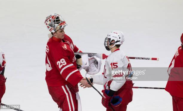 Jake Oettinger of the Boston University Terriers and Trevor Yates of the Cornell Big Red shake hands after the Terriers won 31 during the NCAA...