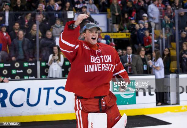 Jake Oettinger of the Boston University Terriers celebrates after being named most valuable player after the Terriers won the Hockey East...