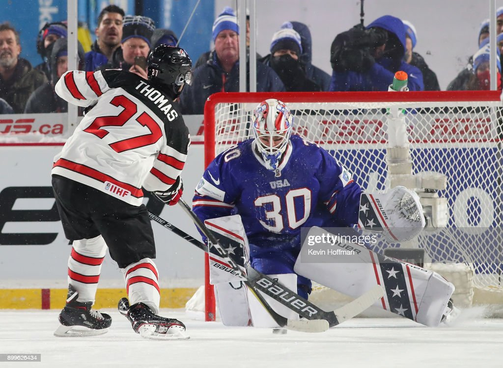 Jake Oettinger #30 of United States makes the save against Robert Thomas #27 of Canada during the IIHF World Junior Championship at New Era Field on December 29, 2017 in Buffalo, New York. The United States beat Canada 4-3.