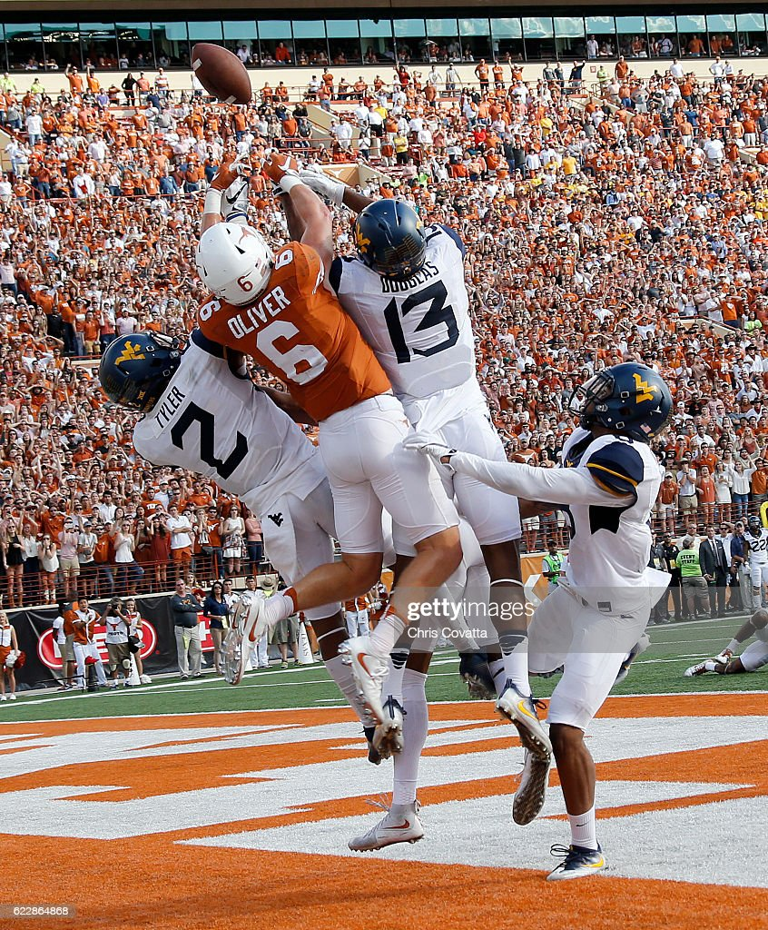 Jake Oliver #6 of the Texas Longhorns battles Jeremy Tyler #2, Rasul Douglas #13 and Kyzir White #8 of the West Virginia Mountaineers for a last second pass from Shane Buechele #7 of the Texas Longhorns at Darrell K Royal -Texas Memorial Stadium on November 12, 2016 in Austin, Texas.