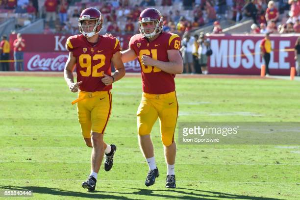 Jake Olson runs on to the field with USC Wyatt Schmidt during a college football game between the Oregon State Beavers and the USC Trojans on October...