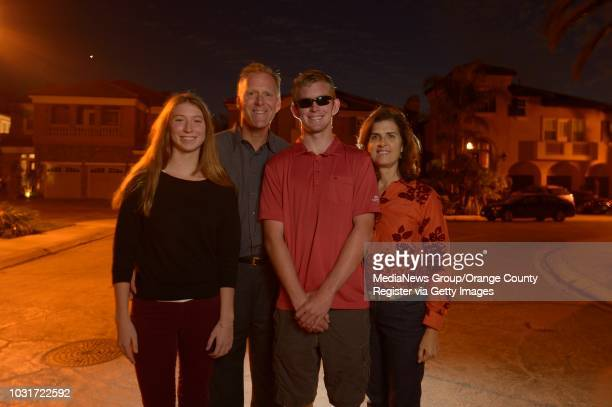 Jake Olson the long snapper for Orange Lutheran High center with his twin sister Emma Olson and parents Brian and Cindy Olsen in their Huntington...
