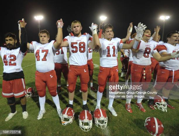 Jake Olson the long snapper for Orange Lutheran High with his team after a game against St John Bosco in Bellflower Olson is blind yet he plays...
