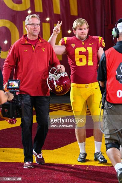 Jake Olson walks out of the tunnel with his dad during a college football game between the Notre Dame Fighting Irish and the USC Trojans on November...