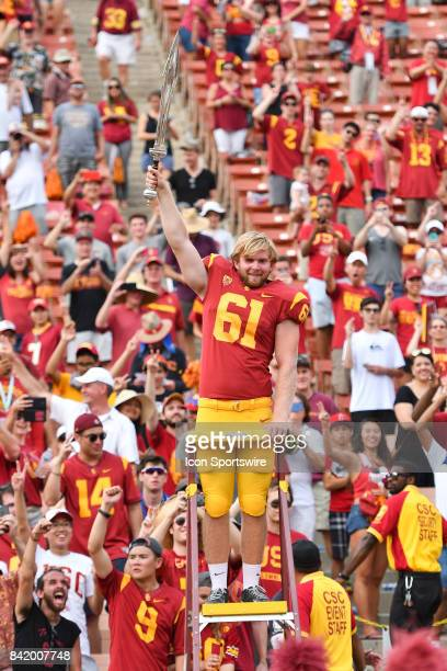 Jake Olson who is blind directs the band after playing in his first NCAA Football game between the Western Michigan Broncos and the USC Trojans on...