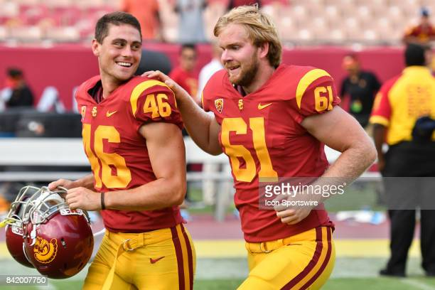 Jake Olson who is blind runs off the field with USC Wyatt Schmidt after playing in his first NCAA Football game between the Western Michigan Broncos...