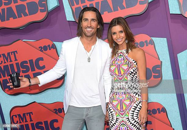 Jake Owen and Lacey Buchanan attend the 2014 CMT Music awards at the Bridgestone Arena on June 4 2014 in Nashville Tennessee