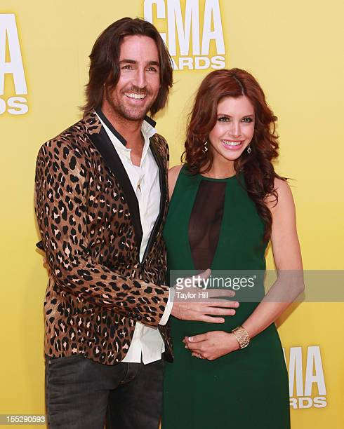 Jake Owen and Lacey Buchanan Owen attend the 46th annual CMA Awards at the Bridgestone Arena on November 1 2012 in Nashville Tennessee
