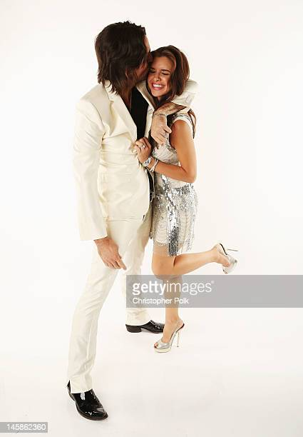 Jake Owen and Lacey Buchanan pose in the Wonderwallcom Portrait Studio during 2012 CMT Music awards at the Bridgestone Arena on June 6 2012 in...