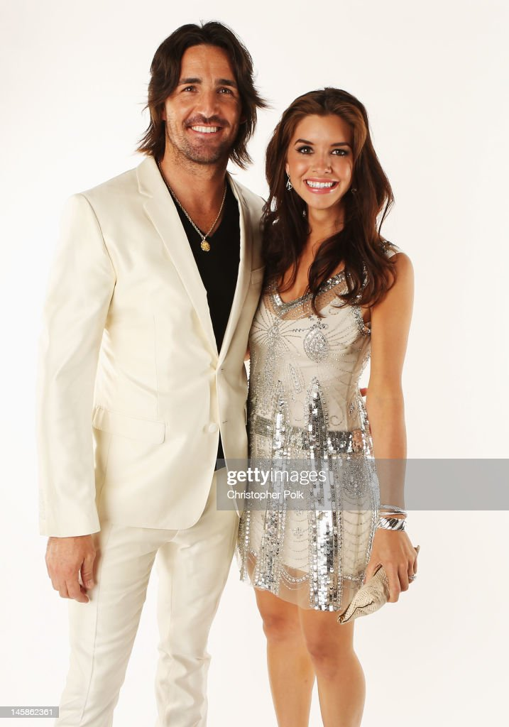 Jake Owen and Lacey Buchanan pose in the Wonderwall.com Portrait Studio during 2012 CMT Music awards at the Bridgestone Arena on June 6, 2012 in Nashville, Tennessee.