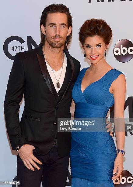 Jake Owen and wife Lacey Buchanan attend the 47th annual CMA Awards at the Bridgestone Arena on November 6 2013 in Nashville Tennessee
