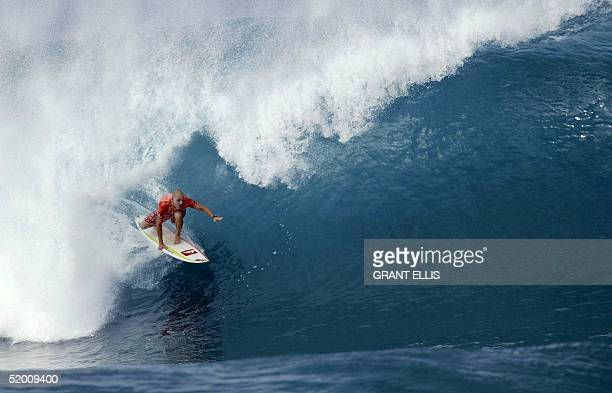 Jake Paterson of Australia rides low to dominate his opening heat to advance directly to round three of the XBOX Pipeline Masters at Banzai Pipeline...