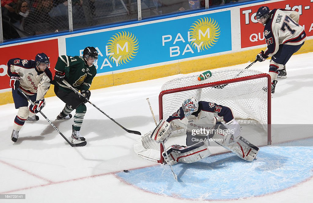 Jake Paterson #57 of the Saginaw Spirit keeps an eye on Chris Tierney #71 of the London Knights in a first round playoff game on March 24, 2013 at the Budweiser Gardens in London, Ontario, Canada. The Knights defeated the Spirit 3-2 in double overtime to take a 2-0 series lead.