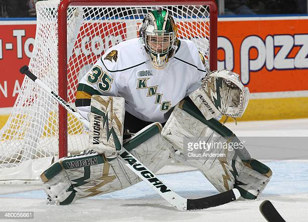 Jake Patterson of the London Knights gets set to face a shot against the Sarnia Sting during an OHL game at Budweiser Gardens on December 31 2013 in...
