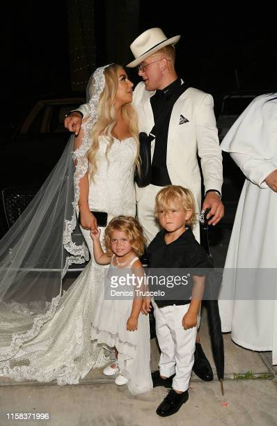Jake Paul and Tana Mongeau pose for a photo during their wedding at Graffiti House on July 28 2019 in Las Vegas Nevada