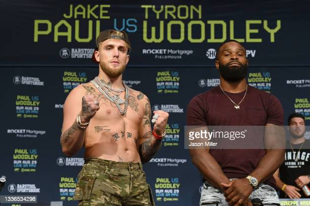 Jake Paul and Tyron Woodley pose during a press conference at the Hilton Cleveland Downtown prior to their August 29 fight on August 26, 2021 in...