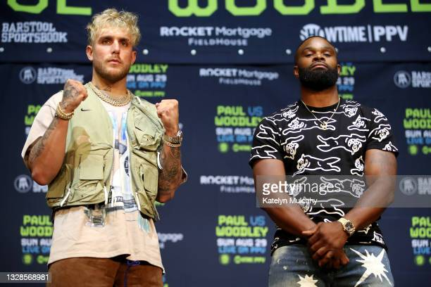 Jake Paul and Tyron Woodley pose for media during a press conference before their cruiserweight fight at The Novo by Microsoft at L.A. Live on July...
