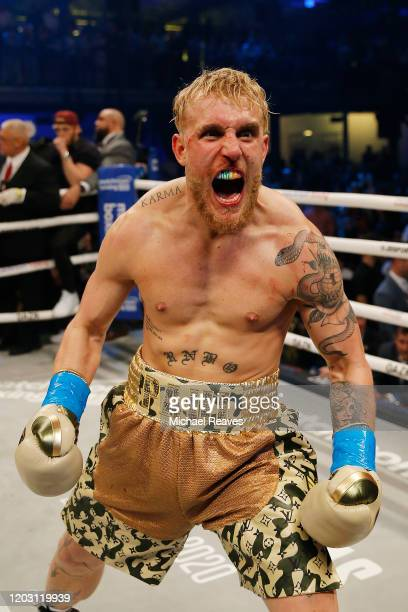 Jake Paul celebrates after defeating AnEsonGib in a first round knockout during their fight at Meridian at Island Gardens on January 30, 2020 in...