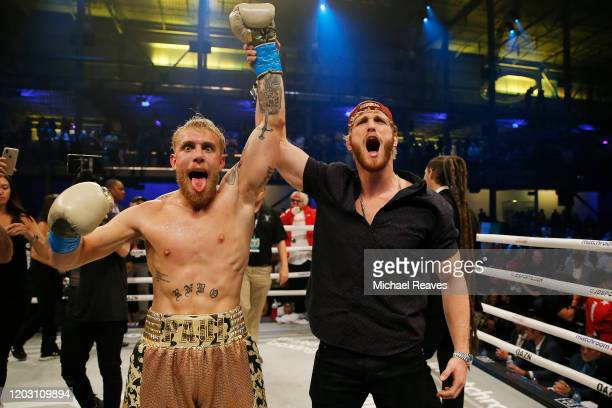 Jake Paul celebrates with his brother, Logan, after defeating AnEsonGib in a first round knockout during their fight at Meridian at Island Gardens on...