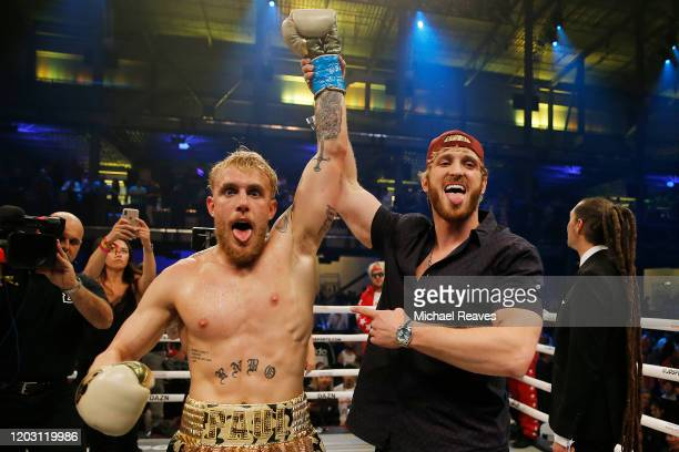 Jake Paul celebrates with his brother Logan after defeating AnEsonGib in a first round knockout during their fight at Meridian at Island Gardens on...