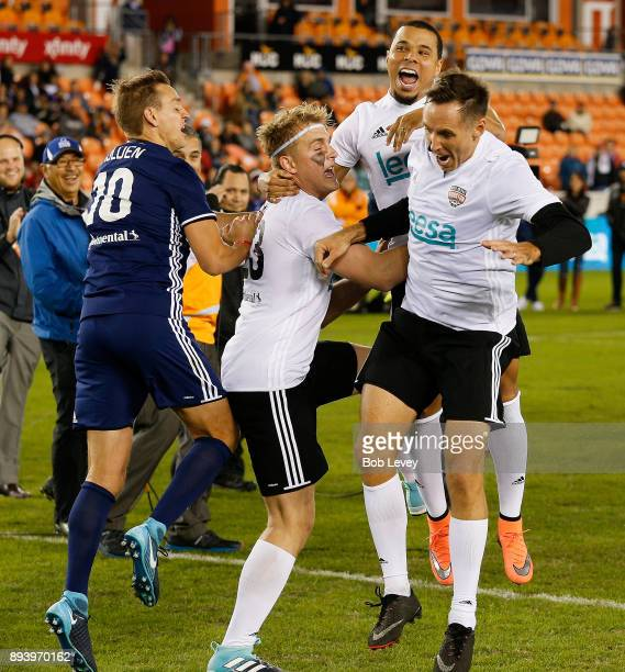 Jake Paul celebrates with Stuart Holden Charlie Davies and Steve Nash after making a shot in the Skillz Challenge during the Kick In For Houston...