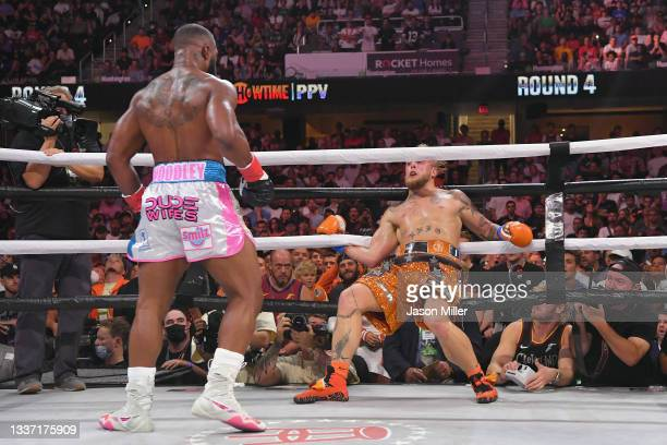 Jake Paul fights Tyron Woodley in their cruiserweight bout during a Showtime pay-per-view event at Rocket Morgage Fieldhouse on August 29, 2021 in...
