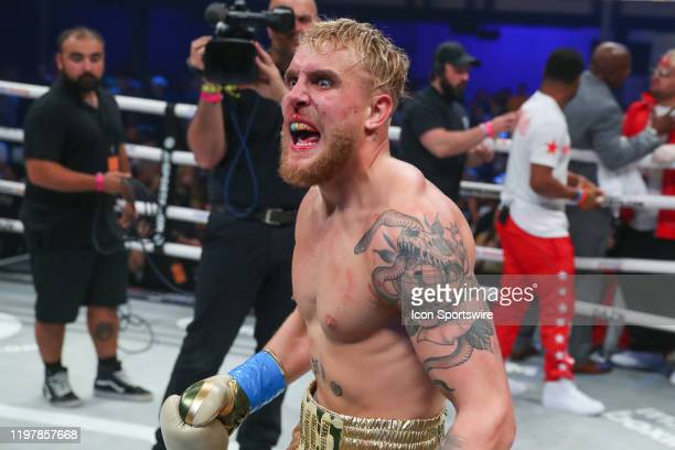 Jake Paul of Los Angeles California celebrates after winning his boxing pro debut on January 30, 2020 part of Matchroom Boxing and DAZN Miami Fight...