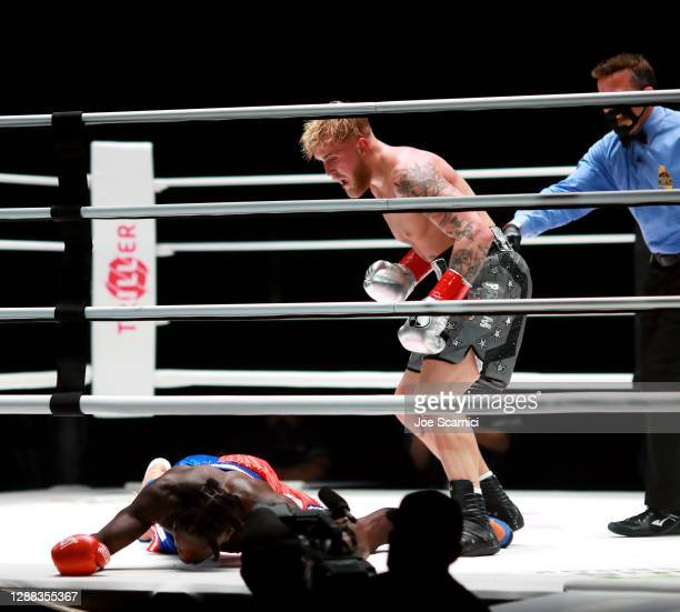 Jake Paul reacts over his knockout victory against Nate Robinson in the second round during Mike Tyson vs Roy Jones Jr. Presented by Triller at...