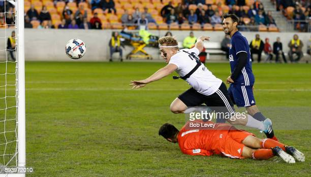 Jake Paul scores as he dives over the goalkeeper during the Kick In For Houston Charity Soccer Match at BBVA Compass Stadium on December 16 2017 in...
