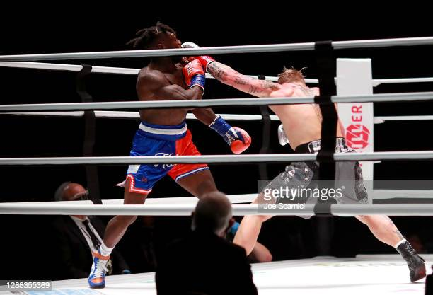 Jake Paul throws a punch against Nate Robinson in the second round during Mike Tyson vs Roy Jones Jr. Presented by Triller at Staples Center on...
