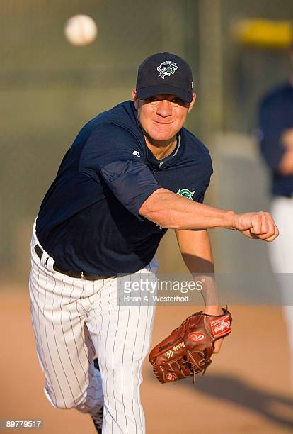 Jake Peavy of the Charlotte Knights warms up in the bullpen prior to pitching in a rehab start against the Pawtucket Red Sox at Knights Stadium on...