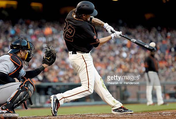 Jake Peavy of the San Francisco Giants hits a bases loaded tworun rbi single against the Miami Marlins in the bottom of the fourth inning at ATT Park...