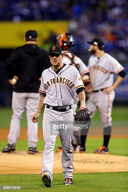 Jake Peavy of the San Francisco Giants walks to the dugout after getting pulled from the game in the second inning during Game Six of the 2014 World...