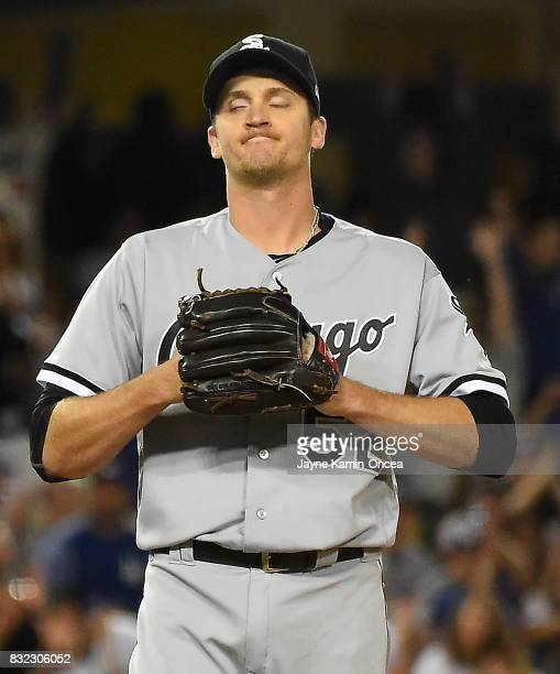 Jake Petricka of the Chicago White Sox grimaces after hitting Joc Pederson of the Los Angeles Dodgers with a pitch which allowed the winning run to...