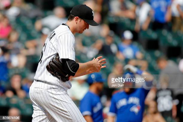 Jake Petricka of the Chicago White Sox reacts after throwing a wild pitch allowing the Toronto Blue Jays to score a run during the eighth inning at...
