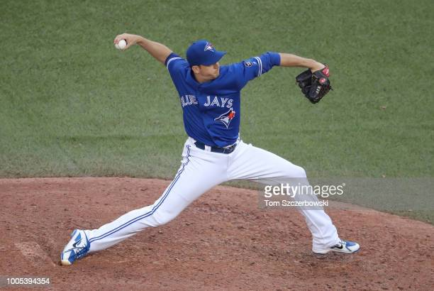 Jake Petricka of the Toronto Blue Jays delivers a pitch in the eleventh inning during MLB game action against the Minnesota Twins at Rogers Centre on...
