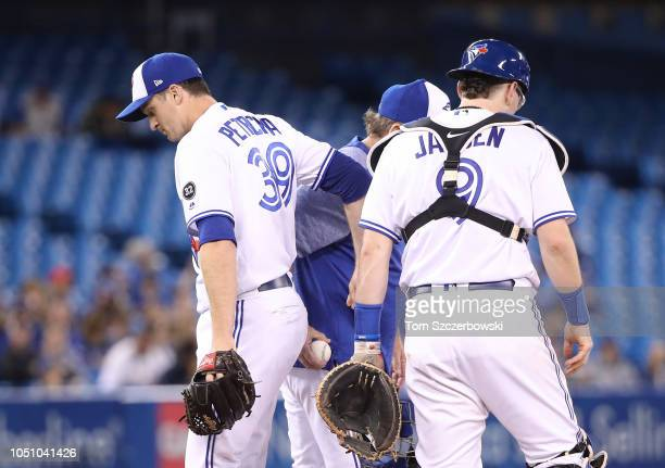 Jake Petricka of the Toronto Blue Jays exits the game as he is relieved by manager John Gibbons in the sixth inning during MLB game action against...