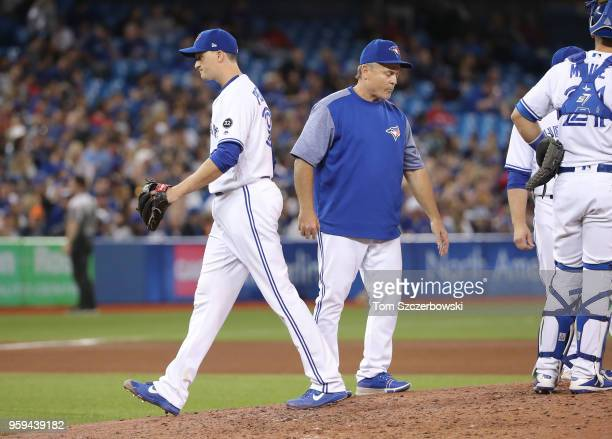Jake Petricka of the Toronto Blue Jays exits the game as he is relieved by manager John Gibbons in the seventh inning during MLB game action against...