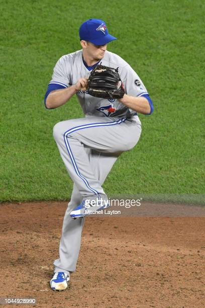 Jake Petricka of the Toronto Blue Jays pitches during a baseball game against the Baltimore Orioles at Oriole Park at Camden Yards on September 18...