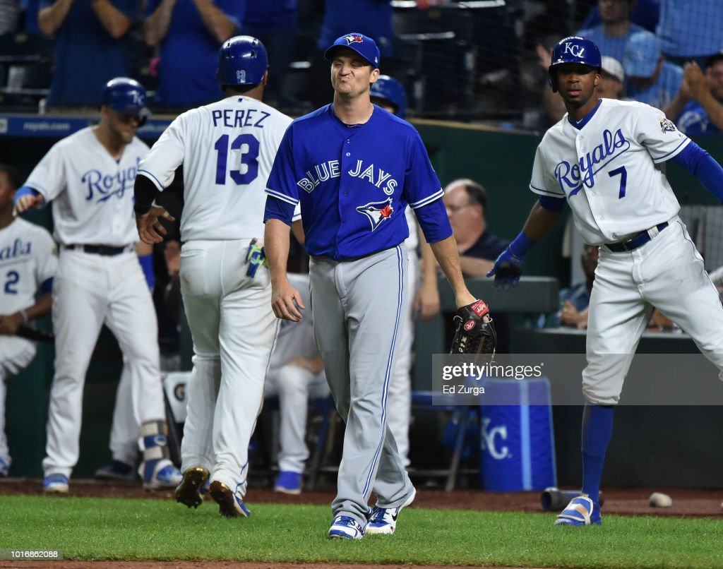 Jake Petricka #39 of the Toronto Blue Jays reacts after giving up a RBI double to Jorge Bonifacio #38 of the Kansas City Royals to score Salvador Perez #13 in the seventh inning at Kauffman Stadium on August 14, 2018 in Kansas City, Missouri.