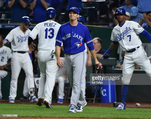 Jake Petricka of the Toronto Blue Jays reacts after giving up a RBI double to Jorge Bonifacio of the Kansas City Royals to score Salvador Perez in...