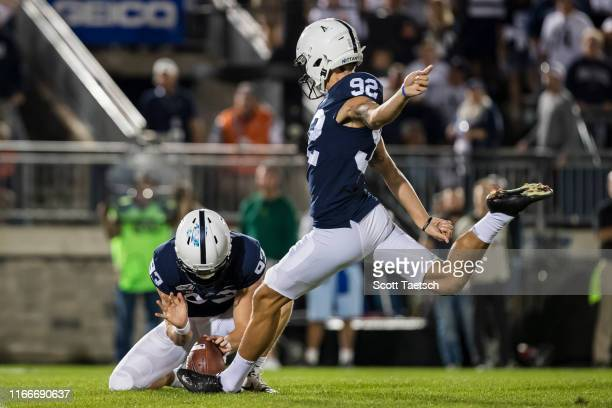 Jake Pinegar of the Penn State Nittany Lions kicks an extra point against the Buffalo Bulls during the second half at Beaver Stadium on September 07...